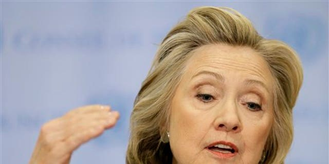 FILE - In this March 10, 2015, file photo, former Secretary of State Hillary Clinton speaks to the reporters at United Nations headquarters. (AP Photo/Seth Wenig, File)