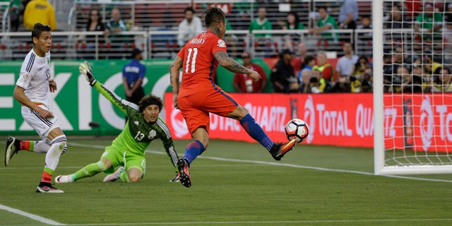CORRECTS THAT THERE WAS NO GOAL, AS OFFSIDE WAS CALLED - Chileâs Eduardo Vargas hits the ball toward the goal against Mexico, but offside was called, during a Copa America Centenario soccer quarterfinal in Santa Clara, Calif., Saturday, June 18, 2016. (AP Photo/ Marcio Jose Sanchez)