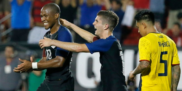 Darlington Nagbe and Christian Pulisic celebrate on Wednesday, May 25, 2016, in Frisco, Texas.