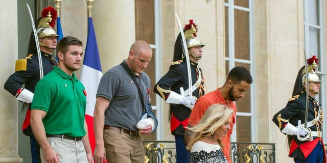 Alek Skarlatos, left, U.S. Airman Spencer Stone, second left, and Anthony Sadler, right, a senior at Sacramento State University, were awarded the French Legion of Honor for stopping the would-be attacker in 2015.