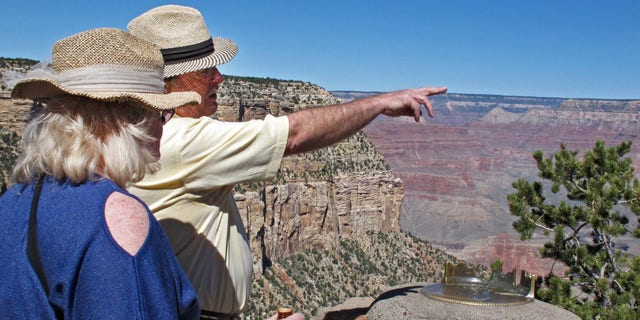 Karen and Tom Jacobs, of Carrollton, Texas, look out over the South Rim of the Grand Canyon on Monday, Sept. 30, 2013.