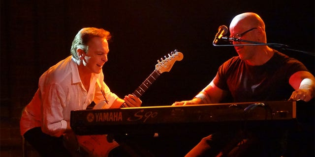 David Cassidy performs with band member and close friend Craig J. Snider in 2015.