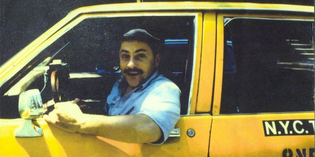 "Jerry Torre, also known as the ""Marble Faun,"" driving a taxi in New York City."