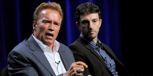 """Aug. 3, 2012: Former California Gov. Arnold Schwarzenegger, left, the subject of a forthcoming ESPN short film, answers a question as the film's co-director Michael Zimbalist looks on during the ESPN Films """"30 for 30 Shorts"""" TCA panel discussion at the Beverly Hilton hotel in Beverly Hills, Calif."""