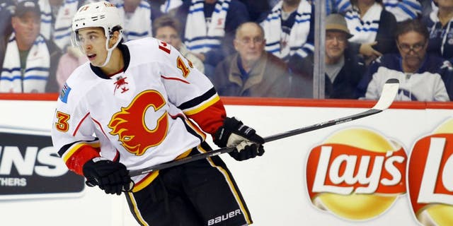 Oct 19, 2014; Winnipeg, Manitoba, CAN; Calgary Flames forward Johnny Gaudreau (13) during the third period against the Winnipeg Jets at MTS Centre. Calgary wins 4-1. Mandatory Credit: Bruce Fedyck-USA TODAY Sports