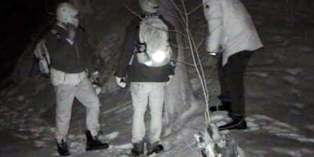 The Royal Canadian Mounted Police intercepted 7,326 people at the border between April and July, according to official figures; This undated surveillance photo provided by U.S. Customs and Border Protection shows people illegally crossing the United States border from Canada near Derby Line, Vt