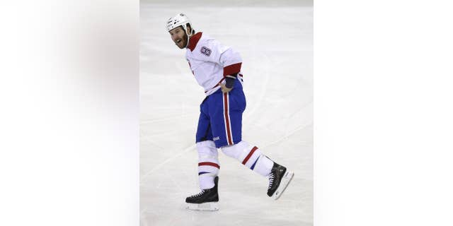 Montreal Canadiens' Brandon Prust yells after fighting during the first period of Game 3 of the NHL hockey Stanley Cup playoffs Eastern Conference finals against the New York Rangers, Thursday, May 22, 2014, in New York. The Canadiens defeated the Rangers in overtime, 3-2. (AP Photo/Seth Wenig)