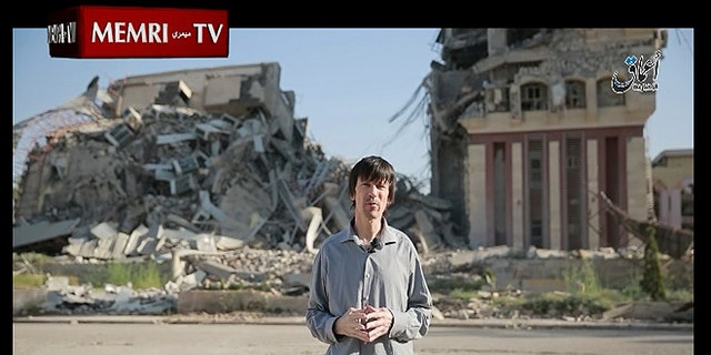 """British Journalist and ISIS captive John Cantlie, 45, is seen looking frail and gaunt as he """"reports"""" on the bombing of Mosul University by coalition forces."""