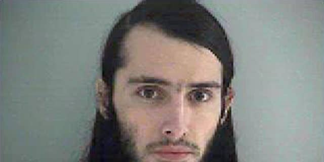 FILE-This Wednesday Jan. 14, 2015 file photo made available by the Butler County Jail shows Christopher Lee Cornell. A judge says an interview with Cornell, an Ohio man accused of plotting to attack the U.S. Capitol can be broadcast by a Cincinnati TV station. Cornell is charged with attempted murder of U.S. officials and other counts. WXIX-TV interviewed him by telephone Thursday from the Kentucky jail where he awaits trial in Cincinnati. (AP Photo/Butler County Jail, File)