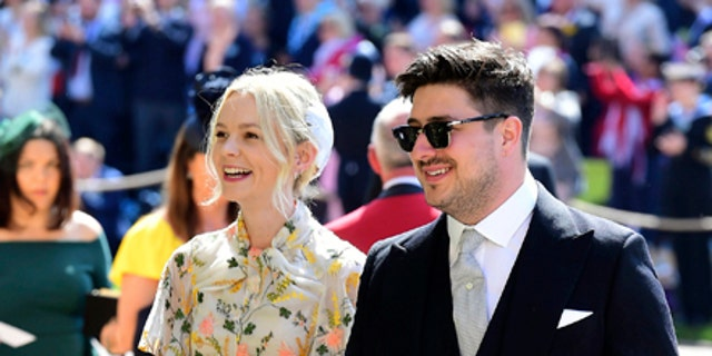 Marcus Mumford and Carey Mulligan arrive for the wedding ceremony of Prince Harry and Meghan Markle at St. George's Chapel in Windsor Castle in Windsor, near London, England, Saturday, May 19, 2018. (Ian West/pool photo via AP)