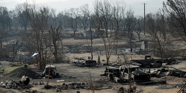 Burned out cars sitting in a neighborhood burned in the Carr Fire are seen on Saturday in Redding.