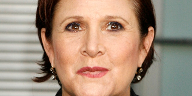 """Actress Carrie Fisher arrives for the premiere of her new film """"Sorority Row"""" in Hollywood, California September 3, 2009."""