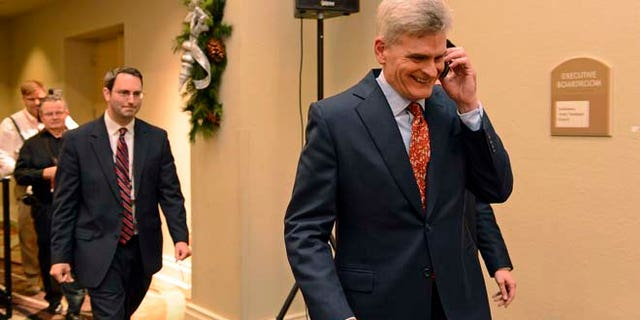 Dec. 6, 2014: Louisiana Senatorial Candidate, Bill Cassidy, right, takes a call while going to meet supporters at his election watch party in Baton Rouge, La. (AP)