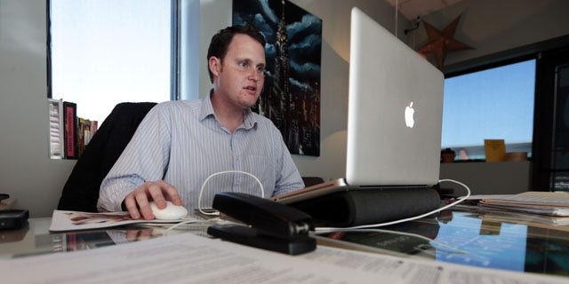 November 13, 2013: Jeremy Bills works at his job as associate director at the Nashville Education Community and Arts Television office in Nashville, Tenn. Bills, originally from Tampa, Fla., received his master's degree from Vanderbilt University in Nashville and has stayed in his college town while trying unsuccessfully to find a job in his field of study.After initial signs of recovery, U.S. mobility for young adults has fallen to the lowest level in more than 50 years. (AP Photo)