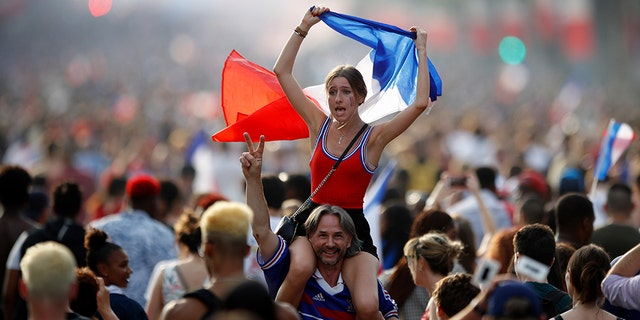 People celebrating on the Champs-Elysees in Paris after France won the World Cup on Sunday.