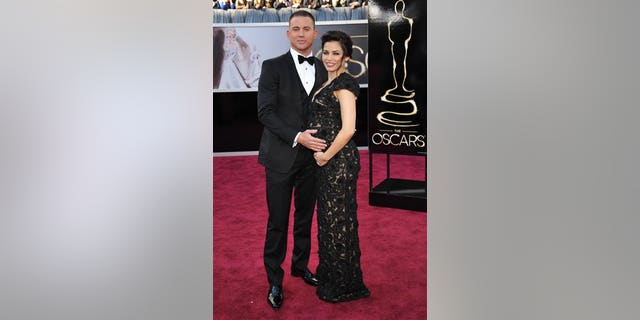 Channing Tatum, left, and Jenna Dewan-Tatum arrive at the 85th Academy Awards at the Dolby Theatre on Sunday Feb. 24, 2013, in Los Angeles. (Photo by John Shearer/Invision/AP)