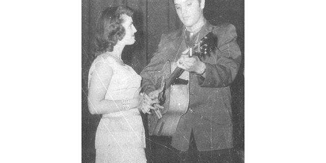 Wanda Jackson admiring Elvis Presley.
