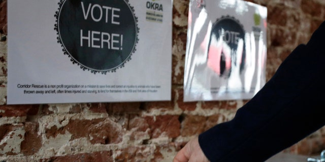 Jan. 16, 2013: A patron drops a ticket into a voting box at the Original OKRA Charity Saloon in Houston.