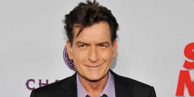 "In this April 11, 2013, file photo, Charlie Sheen, a cast member in ""Scary Movie V,"" poses at the Los Angeles premiere of the film at the Cinerama Dome in Los Angeles."