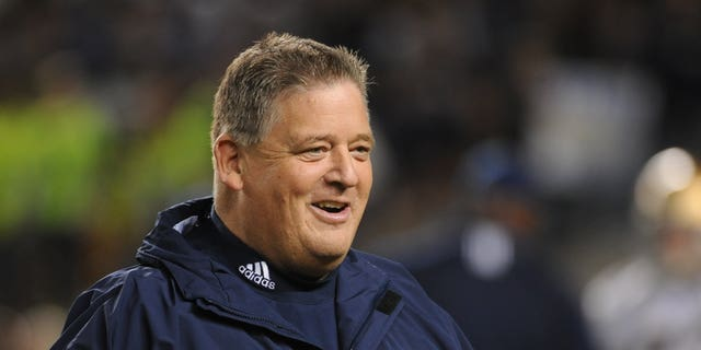 Charlie Weis had two head coaching stints in college football.