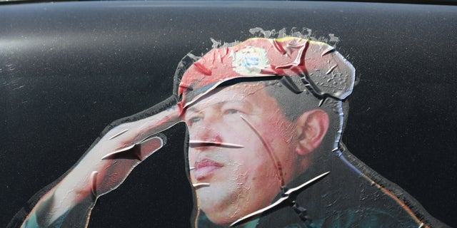 CARACAS, VENEZUELA - MARCH 04: A sticker on a car window honors former Venezuelan president Hugo Chavez near the military barracks where Chavez is entombed on March 4, 2014 in Caracas, Venezuela. (Photo by John Moore/Getty Images)