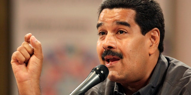 March 13, 2013: Venezuela's acting President Nicolas Maduro speaks at the opening of the Ninth International Book Fair of Venezuela (Filven) which pays tribute to late President Hugo Chavez at the Teresa Carreno theater in Caracas, Venezuela.