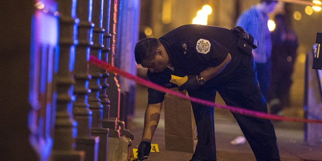 Police mark a crime scene in Chicago, Ill.