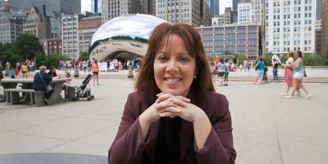 In this photo taken Thursday, June 30, 2016, Friends of the Parks Director Juanita Irizarry poses for a portrait in Chicago's Millennium Park after an interview with the Associated in Chicago. Irizarry heads the obscure nonprofit that stood its ground and blocked Star Wars creator George Lucas' private museum from being built on Chicago's prized lakefront. (AP Photo/Charles Rex Arbogast)