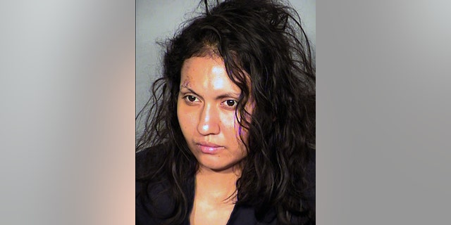 FILE - This undated booking photo provided by the Las Vegas Metropolitan Police Department shows Robledo Ibarra, 34, who faces felony charges after police say she tossed her two young children and herself out a second-story window on June 12, 2014. Ibarra was in a wheelchair Monday, June 30, 2014 for her initial court appearance  in Las Vegas on two attempted counts of murder and two charges of child abuse causing substantial bodily harm. Her lawyer, Benson Lee, says he intends to file written documents seeking her release on bail from the Clark County jail. (AP Photo/Las Vegas Metropolitan Police Department,File)