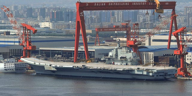 Aug. 6: In this photo, a Chinese aircraft carrier, which had been under refurbishment, is docked at Dalian port in in northeast Liaoning province. China's first aircraft carrier started sea trials Wednesday, Aug. 10, a step that will likely boost concerns about the country's naval ambitions amid sea territorial disputes.