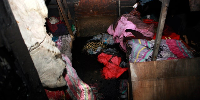Jan. 4, 2013: A charred room with beds and beddings scattered after a fire at a private shelter for orphans and abandoned children in Lankao in central China's Henan province.