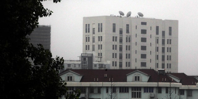 """May 31, 2013: This file photo shows the building housing Unit 61398 of the Peoples Liberation Army, center top, on the outskirts of Shanghai, China. A U.S. security firm, Mandiant, said last year it traced attacks on American and other companies to the military unit in Shanghai.  China on Tuesday, May 20, 2004, warned the United States was jeopardizing military ties by charging five Chinese officers with cyberspying and tried to turn the tables on Washington by calling it """"the biggest attacker of China's cyberspace.""""  (AP)"""