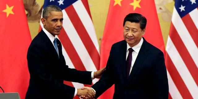 November 12, 2014: U.S. President Barack Obama, left, shakes hands with Chinese President Xi Jinping after their press conference at the Great Hall of the People in Beijing. (AP Photo/Andy Wong)