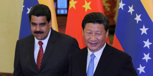 Chinese President Xi Jinping meets with Venezuela's President Nicolas Maduro at the Great Hall of the People September 1, 2015 in Beijing, China. (Photo by Parker Song-Pool/Getty Images)