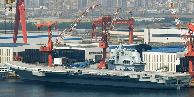 This May 9, 2018, photo released by China's Xinhua News Agency shows China's aircraft carrier Liaoning at a shipyard in Dalian.