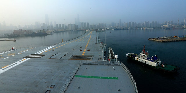 In this photo provided by China's Xinhua News Agency, China's aircraft carrier leaves Dalian in northeast China's Liaoning Province for sea trials Sunday, May 13, 2018.