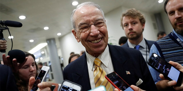 Sen. Chuck Grassley (R-IA) speaks with reporters ahead of the party luncheons on Capitol Hill in Washington, U.S. November 14, 2017.