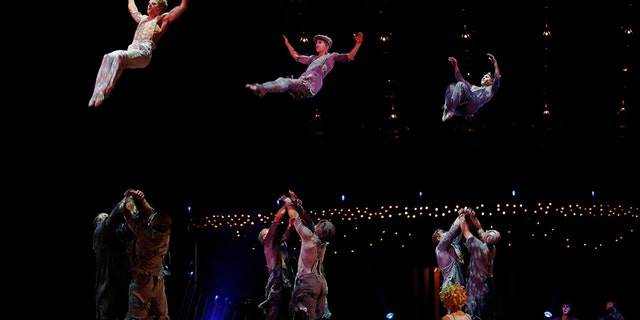 Cirque du Soleil performers appear to fly through the air a dress rehearsal at the Royal Albert Hall in London.
