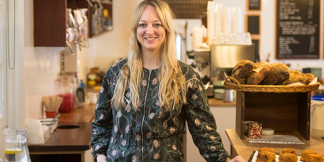 "Claire Ptak, owner of Violet Bakery in Hackney, east London Tuesday March 20, 2018. Ptak has been chosen to make the cake for the wedding in May of Prince Harry and Meghan Markle. Kensington Palace said Tuesday the royal wedding cake will be a lemon elderflower concoction incorporating ""the bright flavors of spring."""