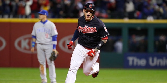 CLEVELAND, OH - OCTOBER 25:  Roberto Perez #55 of the Cleveland Indians reacts as he runs the bases after hitting a three-run home run during the eighth inning against the Chicago Cubs in Game One of the 2016 World Series at Progressive Field on October 25, 2016 in Cleveland, Ohio.  (Photo by Jamie Squire/Getty Images)