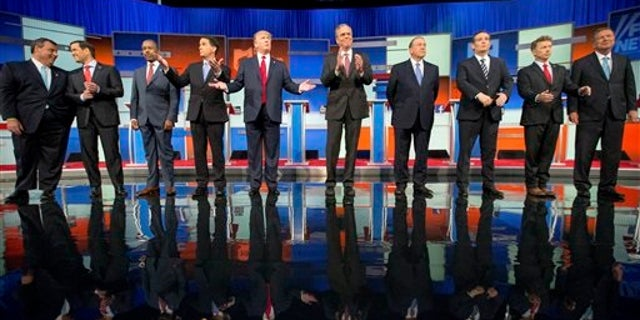 Republican presidential candidates from left, Chris Christie, Marco Rubio, Ben Carson, Scott Walker, Donald Trump, Jeb Bush, Mike Huckabee, Ted Cruz, Rand Paul, and John Kasich take the stage for the first Republican presidential debate at the Quicken Loans Arena, Thursday, Aug. 6, 2015,  in Cleveland. (AP Photo/Andrew Harnik)