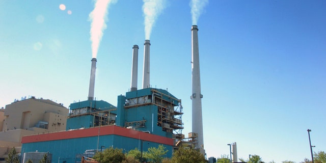 In this July 1, 2013, file photo, smoke rises from the Colstrip Steam Electric Station, a coal burning power plant in in Colstrip, Mont.