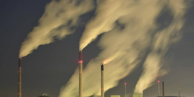 FILE - In this Nov. 24, 2014 file photo, smoke streams from the chimneys of the E.ON coal-fired power station in Gelsenkirchen, Germany. The U.N. weather agency says levels of carbon dioxide and methane, the two most important greenhouse gases, reached record highs last year. Pushed by the burning of coal, oil and gas for energy, global CO2 levels are now 143 percent higher than before the industrial revolution and scientists say that's the main driver of global warming. (AP Photo/Martin Meissner, File)