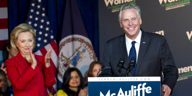Saturday, Oct. 19, 2013.: Former Secretary of State Hillary Clinton applauds Virginia gubernatorial candidate, Democrat Terry McAuliffe, during a campaign rally, Women for Terry, at the State Theater in Falls Church, Va.