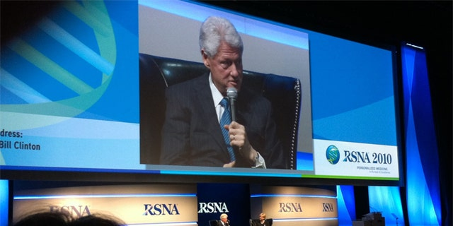 Clinton's appearance raised concerns among members of the Radiological Society of North America, who wanted to know who paid the bill.
