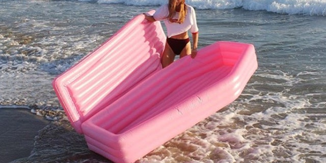 A millennial-pink, coffin-shaped pool float is the new summer must-have, according to the internet.