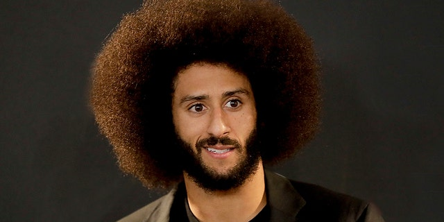 """FILE - In this Dec. 24, 2016, file photo San Francisco 49ers quarterback Colin Kaepernick talks during a news conference after an NFL football game against the Los Angeles Rams. The free agent quarterback was named GQ magazine's """"Citizen of the Year"""" for his activism on Nov. 13, 2017. (AP Photo/Rick Scuteri, File)"""