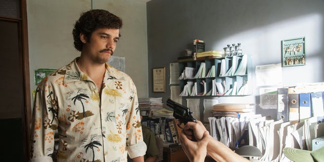"""This undated production photo provided by Netflix, shows actor Wagner Moura as Pablo Escobar, in the Netflix Original Series """"Narcos."""""""