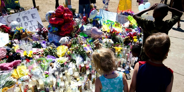 Across the street from the movie theater is a memorial for the victims of the shootings in Aurora, Colorado.
