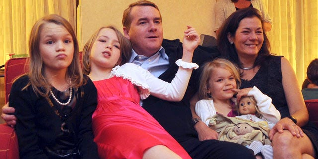 Nov. 2: Democratic candidate for Senate Michael Bennet, center, watches election results with his family at the Marriott in Denver. Into the early hours of the next day, election numbers seemed too close to call.